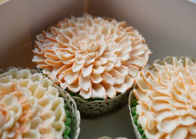 Close up of two tone chrysanthemum cupcakes vegan cupcakes in a box  flower vegan cupcakes, flower vegan cupcakes, dairy free, egg free cupcake art