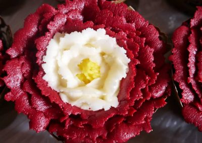 Close Up photo of a tudor rose cupcake that's dairy free and egg free, vegan cake
